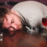 drunk man on wooden table